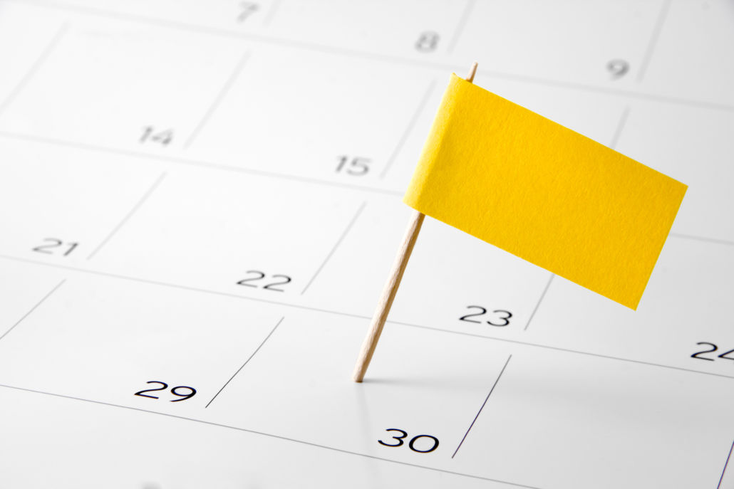 Calendar with 30 marked by a yellow flag