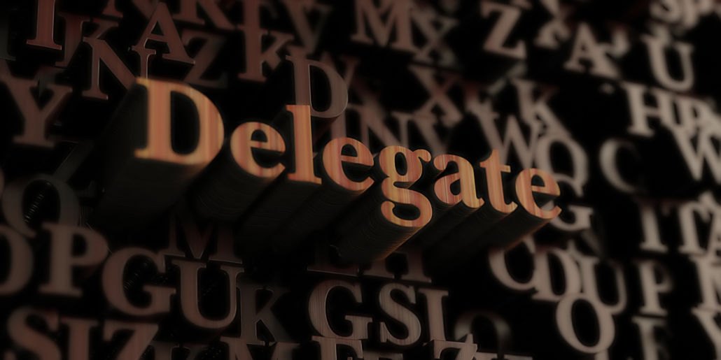 wooden letters with Delegate standing out