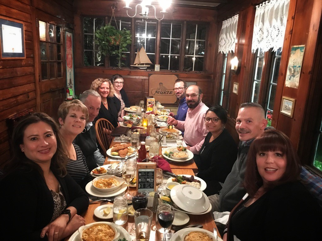 members enjoying dinner out together