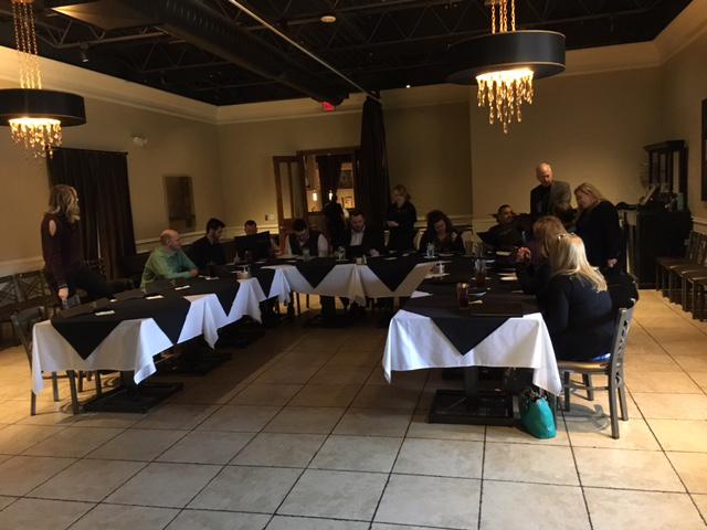 team enjoying lunch around a table