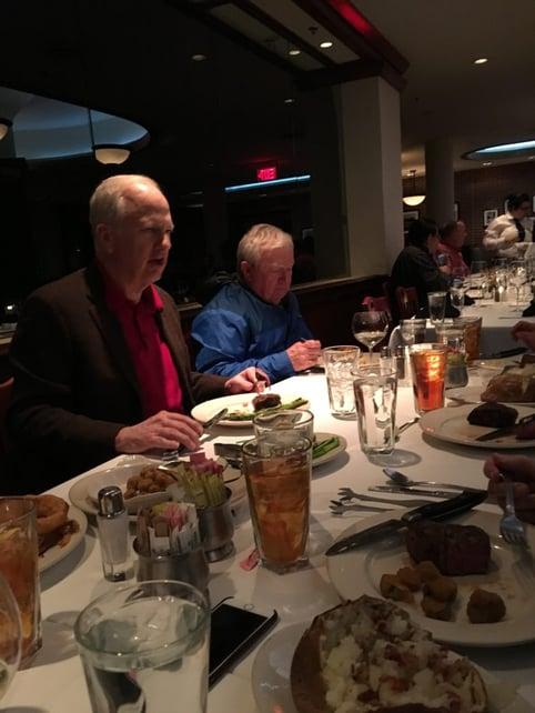 two men eating dinner