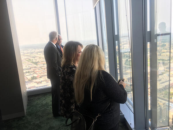 four people looking out over the city