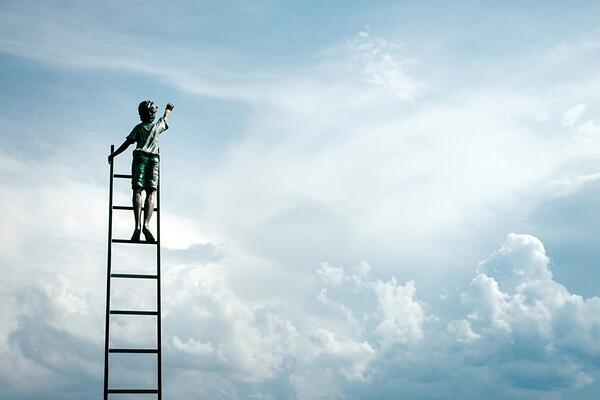child climbing a ladder into the sky