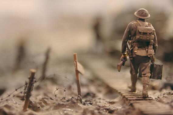 image of a soldier walking along a path