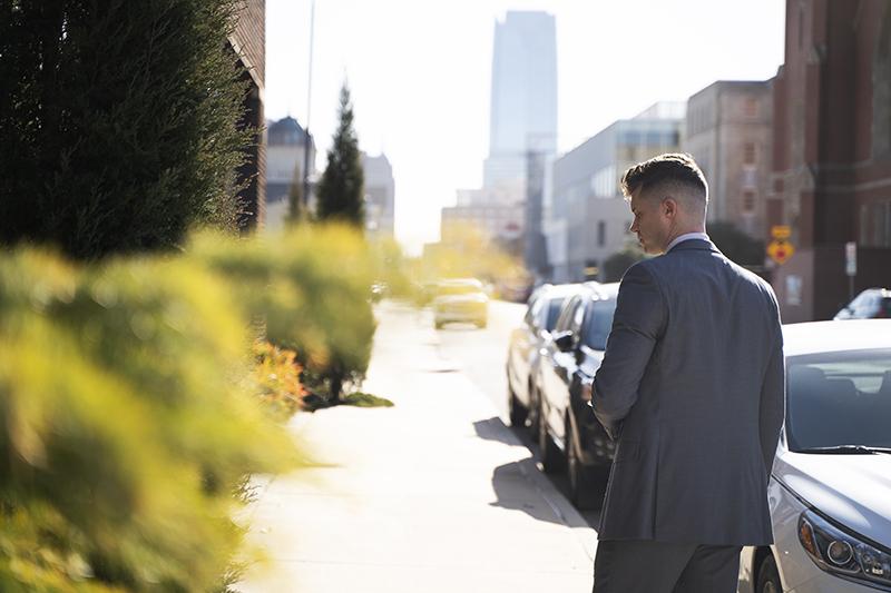 man walking down a city sidewalk