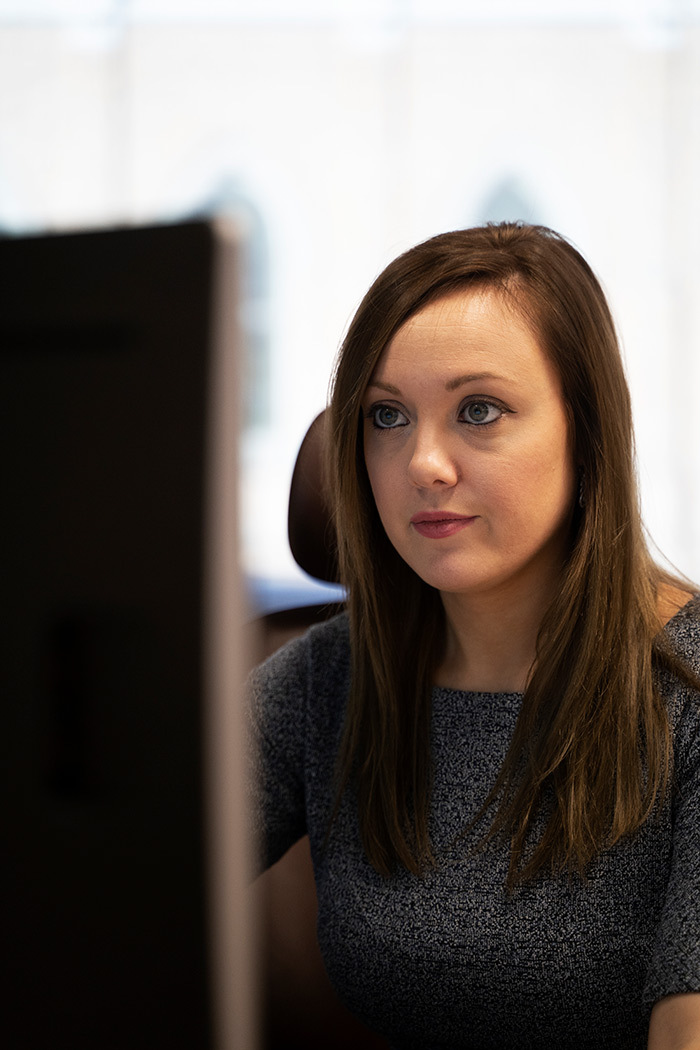 Professional woman doing work on computer