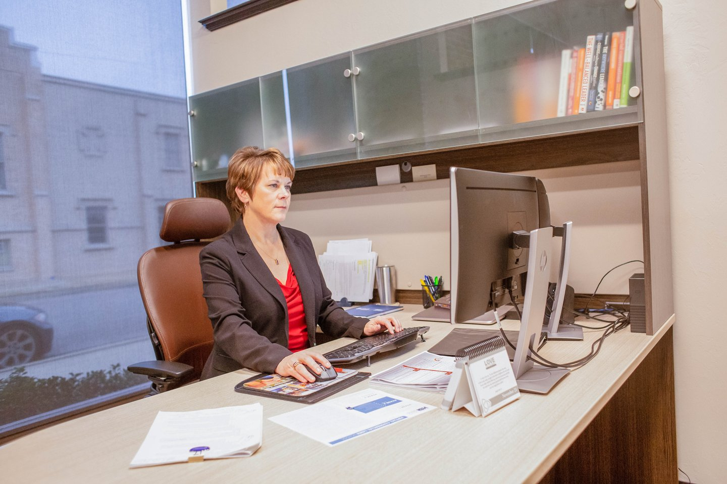 Female business executive working on computer in modern office