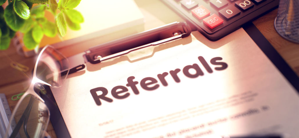 Referrals on Clipboard. Office Desk with a Lot of Office Supplies. 3d Rendering. Blurred and Toned Illustration.