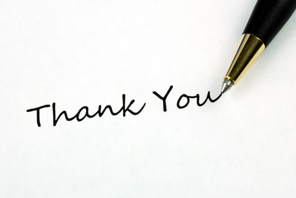 pen writing thank you on a piece of paper