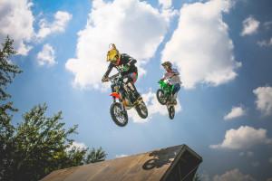 dirt bikers going over a jump