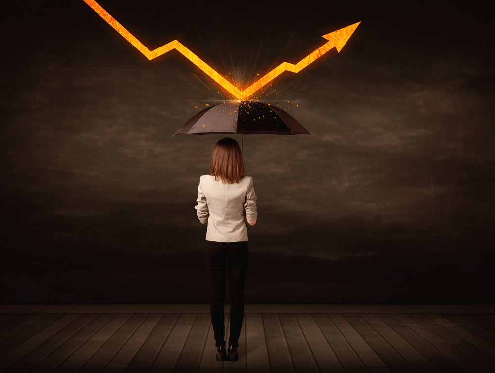 woman standing under an umbrella as a growth chart bounces off of the top