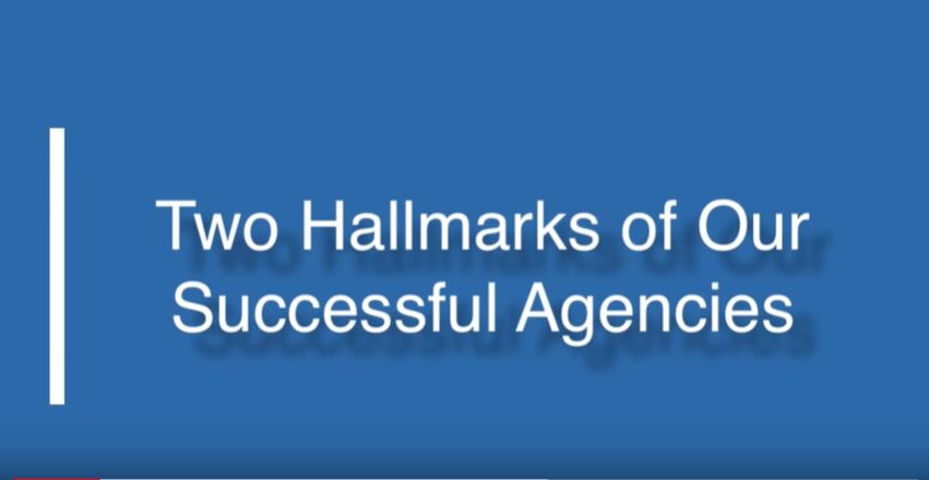 text: two hallmarks of our successful agencies on a blue background